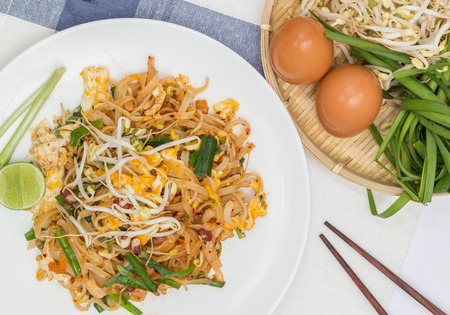 Thailands national dishes, stir-fried rice noodles with egg, vegetable and shrimp (Pad Thai) photo
