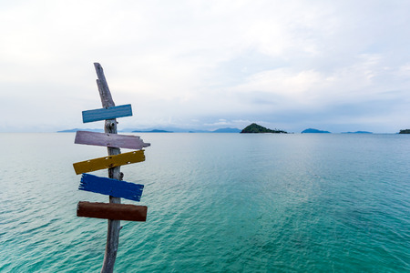 signpost on pier in tropical sea at koh mak island,Thailand photo