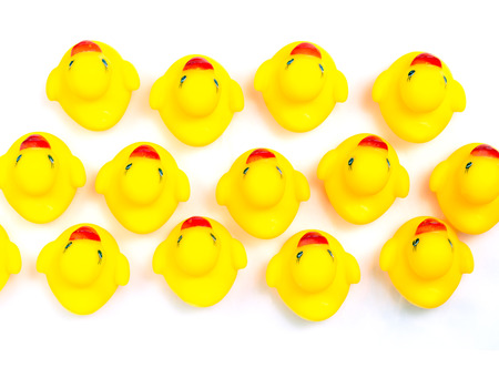 ugly duckling: Group of yellow rubber duck on top view