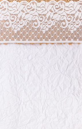 White Ornamental Lace border over white paper and Burlap design for border or background photo