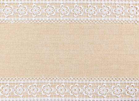 Lace flowers frame on Fabric texture background Standard-Bild