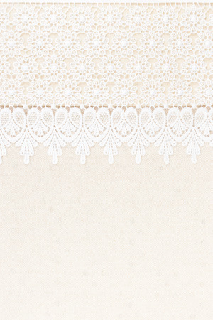 White Ornamental Lace over fabric design for border or background photo