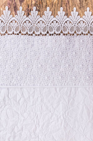 Close up of Lace flowers frame and Burlap over paper texture design for border or background photo