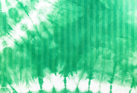 Green tie dye batik fabric for background and texture Stock Photo