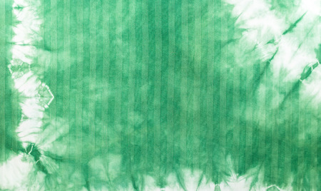 Green tie dye batik fabric for background and texture photo