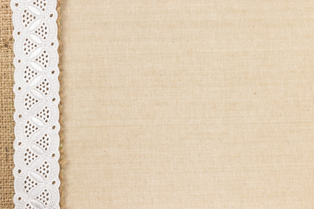 Fabric texture with Burlap and white Lace as border design for background