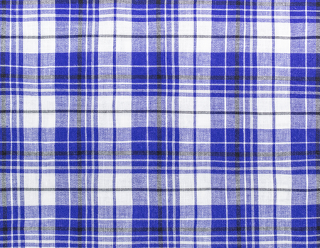 Tartan plaid fabric. Seamless tiles texture for the background photo