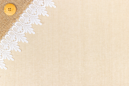 White Ornamental Lace over canvas and Burlap design for border or background photo