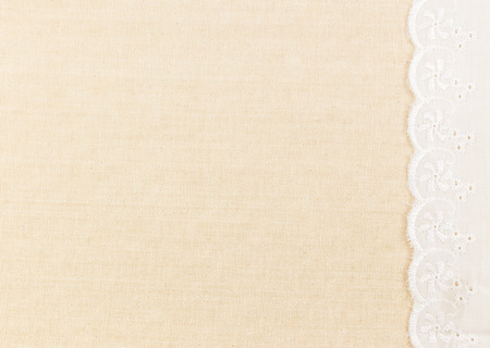 Lace border over Fabric textile texture design for background photo