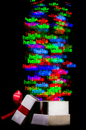 moving out: Defocused hello word  lights are moving out of open gift box