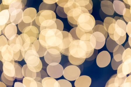 bokeh lights: Festive winter gold abstract. background with bokeh lights