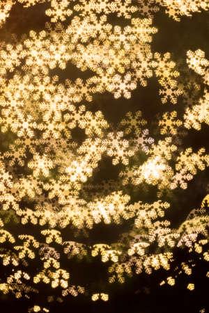 bokeh lights: Snowflakes bokeh  lights Abstract Winter Background Stock Photo