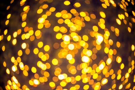 bokeh lights: Gold color bokeh flower shape ,defocused bokeh lights as background