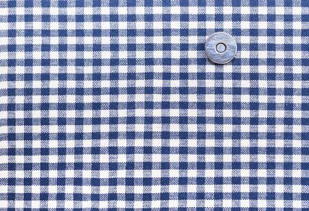 tartan plaid: Seamless tiles Tartan plaid fabric texture for the background with button Stock Photo