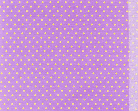 polka dot fabric: Yellow dots over purple  Polka dot fabric background and texture