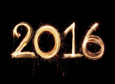 2016 word written with Sparkle firework on black background