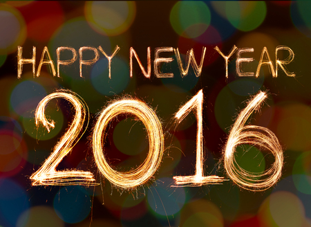 glow pyrotechnics: happy new year 2016 written with Sparkling figures. on bokeh background