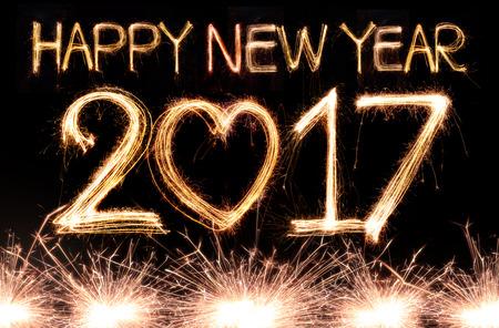 Happy new year 2017 written with Sparkle firework Standard-Bild