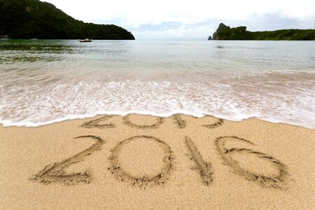 New Years 2016 is coming concept, 2016 replace 2015 concept on the sand beach Stock Photo