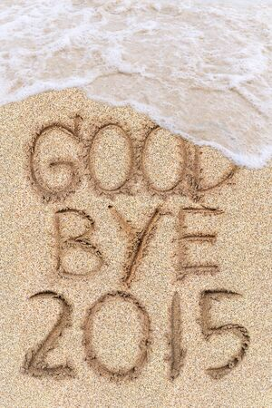 New Years 2016 is coming concept, 2016 replace 2015 concept on the sand beach Standard-Bild