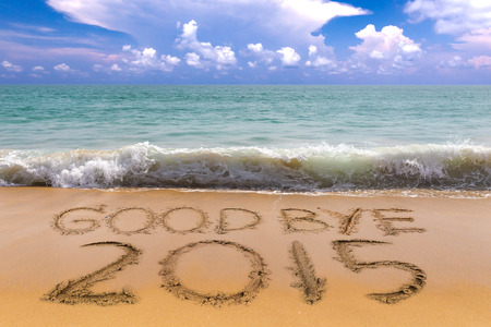 New Years 2016 is coming concept, Goodbye 2015 on the sand beach