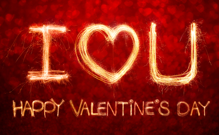 i love u: I love u word written with Sparkle firework over bokeh background for Valentines day