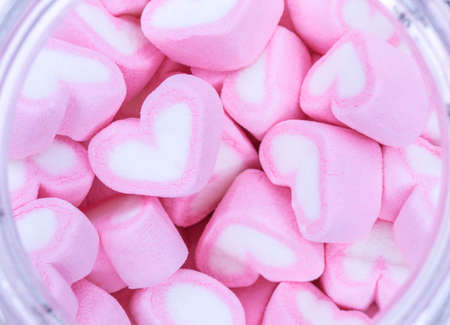 soft colors: Pink and white marshmallows in storage jar