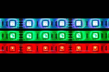 semi conductor: Lines of multicolored LED stripe lights on black background Stock Photo