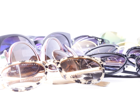 tinted: Collection of assorted styles of tinted sunglasses on white background
