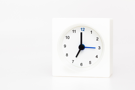 seven o'clock: White Square clock isolated on white background. Time seven oclock
