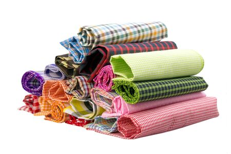 fabric roll: Pile of colorful checkered plaid fabric roll on a white background