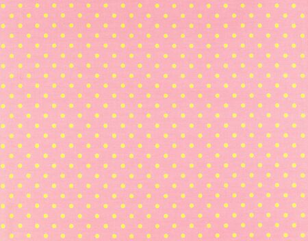polka dot fabric: yellow dots over pink Polka dot fabric background and texture