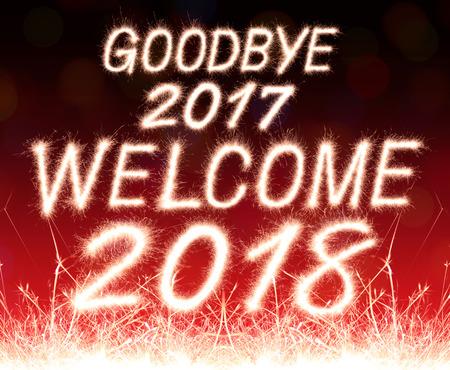 goodbye 2017 welcome 2018 written from Sparkle firework with  Sparkle firework background Standard-Bild