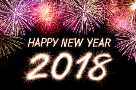 Happy new year 2018 written with Sparkle firecracker and firework Stock Photo