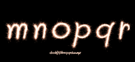 r p m: Lowercase letters Alphabet m,n,o,p,q,r made of sparkler firework light over black background Stock Photo