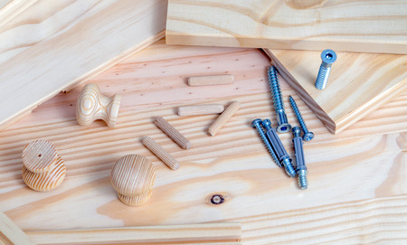 Close up of Furniture assembly kit on wood plank background Stock Photo
