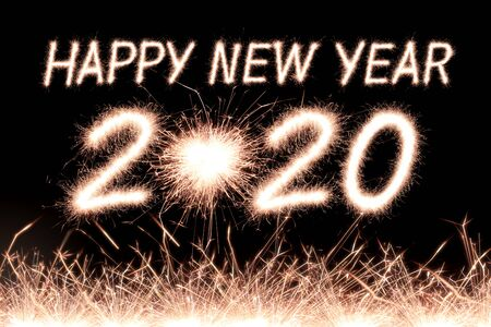 Happy new year, 2020 written with Sparkle firework Banco de Imagens