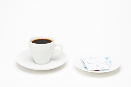 summation: Cup of coffee with bill on white background