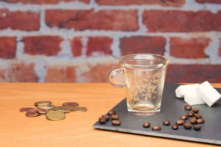 pay wall: Cup of coffee with bill on brick wall