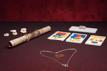 Clairvoyance equipment with weddings rings on dark desk Editorial