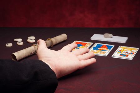Clairvoyance equipment with palm on dark desk