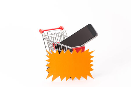 Caddy for shopping  with smartphone on white background photo
