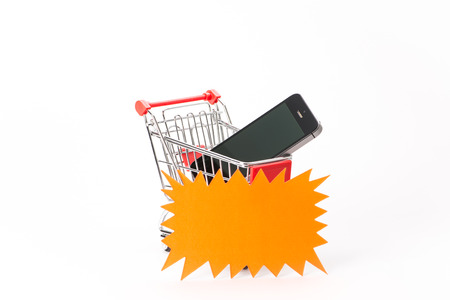 caddie: Caddy for shopping  with smartphone on white background Stock Photo