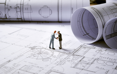 architecture: Architecture plans and sketch of house project with character Stock Photo
