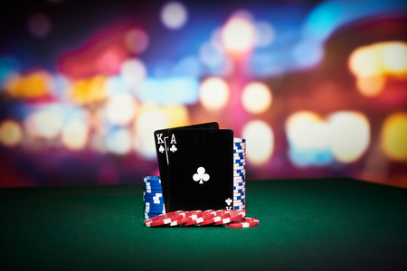 poker card: Poker chips with black cards on table in casino
