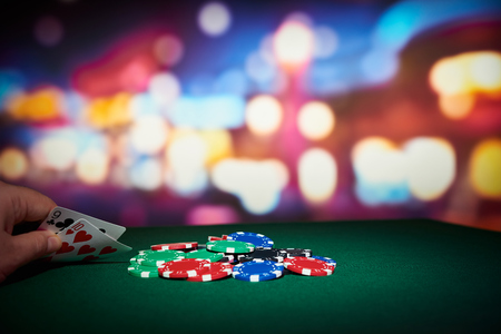 Poker chips with pair of cards on table in casino Standard-Bild