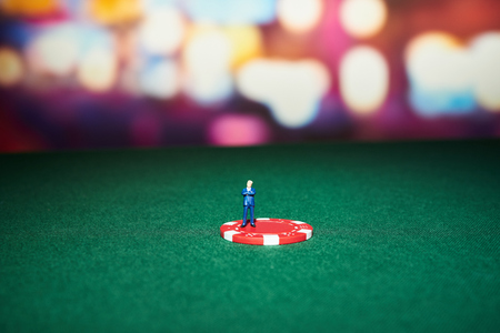 holdem: Poker chips with character on table in casino