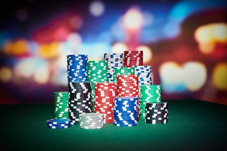 casino table: Poker chips with blur background on table in casino