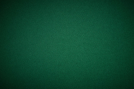 table set: Poker green table in casino with lighting