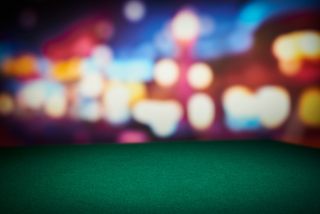 Poker green table in casino with blur background Imagens
